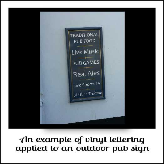 An outdoor pub sign with vinyl letters